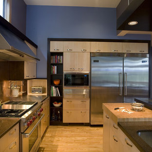 Example of a trendy kitchen design in Portland with stainless steel appliances, quartz countertops, an undermount sink, flat-panel cabinets, light wood cabinets, metallic backsplash and metal backsplash