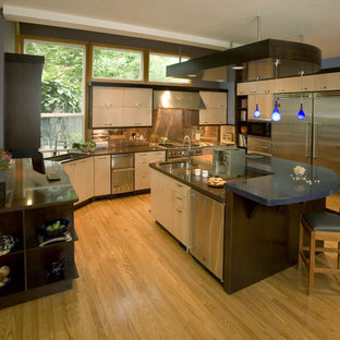 Inspiration for a contemporary kitchen in Portland with stainless steel appliances, quartz benchtops, an undermount sink, flat-panel cabinets, light wood cabinets, metallic splashback, metal splashback and blue benchtop.