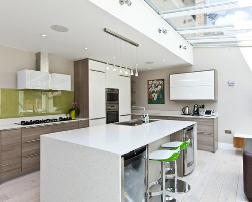 242 white countertop Kitchen Design Photos with Painted Wood Flooring