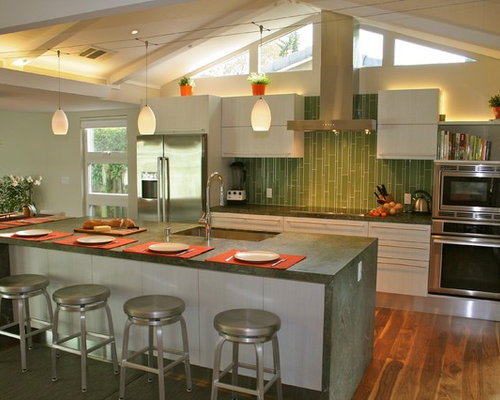 Superbe Example Of A Mid Sized Minimalist Galley Medium Tone Wood Floor Open  Concept Kitchen Design