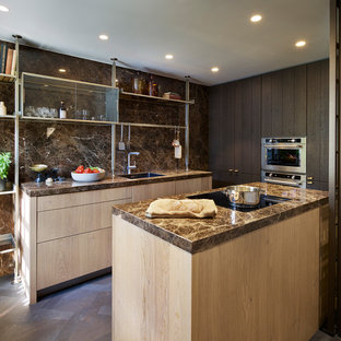 This is an example of a small contemporary galley kitchen in Oxfordshire with a submerged sink, light wood cabinets, brown splashback, marble splashback, stainless steel appliances, dark hardwood flooring, no island, brown floors and black worktops.