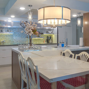Mid-sized trendy single-wall light wood floor and beige floor eat-in kitchen photo in Other with a double-bowl sink, flat-panel cabinets, white cabinets, quartz countertops, gray backsplash, mosaic tile backsplash, stainless steel appliances and an island