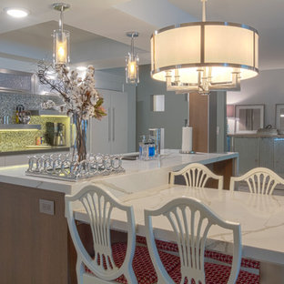 Inspiration for a mid-sized contemporary single-wall light wood floor and beige floor eat-in kitchen remodel in Other with a double-bowl sink, flat-panel cabinets, white cabinets, quartz countertops, gray backsplash, mosaic tile backsplash, stainless steel appliances and an island