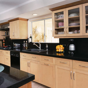 Photo of a large contemporary single-wall separate kitchen in Miami with a double-bowl sink, shaker cabinets, light wood cabinets, recycled glass benchtops, black splashback, glass tile splashback, black appliances and with island.