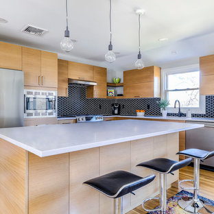 Mid-sized contemporary kitchen ideas - Kitchen - mid-sized contemporary l-shaped light wood floor and beige floor kitchen idea in New York with flat-panel cabinets, light wood cabinets, quartzite countertops, black backsplash, porcelain backsplash, stainless steel appliances, an island and white countertops