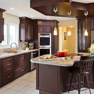Contemporary kitchen with dark cabinets and recycled granite and glass counter t