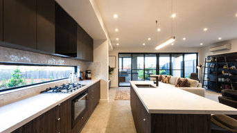 Contemporary kitchen with letterbox window and sliding doors