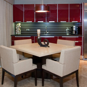 Contemporary Kitchen with Red Glass Cabinetry