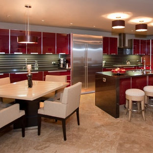 Mid-sized contemporary l-shaped open plan kitchen in Other with stainless steel appliances, red cabinets, an undermount sink, glass-front cabinets, quartz benchtops, brown splashback, marble floors, stone slab splashback, a peninsula, beige floor and brown benchtop.