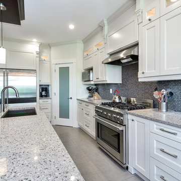 Contemporary kitchen with shaker style cabinets Vancouver