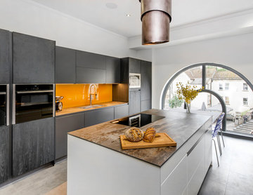 Contemporary kitchen with vibrant indian yellow