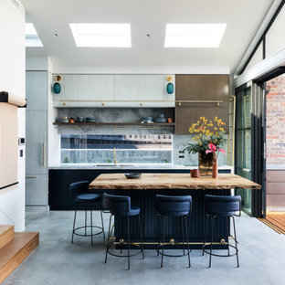Inspiration for a contemporary galley kitchen in Sydney with marble benchtops, grey splashback, marble splashback, concrete floors, with island, grey floor, multi-coloured benchtop, an undermount sink, flat-panel cabinets and grey cabinets.