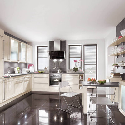 Inspiration for a contemporary kitchen remodel in Boston with paneled appliances