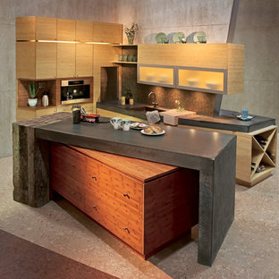 Contemporary kitchen in Minneapolis with flat-panel cabinets, light wood cabinets, concrete benchtops, green splashback, glass sheet splashback and cork floors.