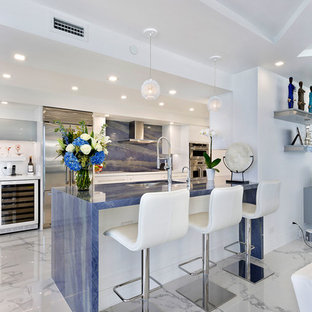 Medium sized contemporary galley kitchen/diner in Miami with a submerged sink, flat-panel cabinets, white cabinets, marble worktops, blue splashback, marble splashback, stainless steel appliances, marble flooring, no island, multi-coloured floors and blue worktops.