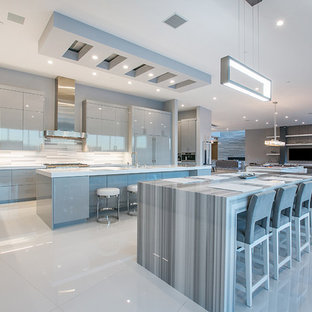 Huge contemporary open concept kitchen appliance - Inspiration for a huge contemporary open concept kitchen remodel in Las Vegas with flat-panel cabinets, gray cabinets, multicolored backsplash, paneled appliances and two islands