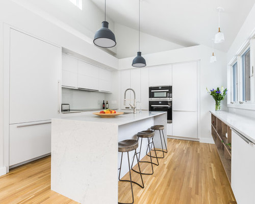 Mid Sized Contemporary Kitchen Ideas   Example Of A Mid Sized Trendy Light  Wood