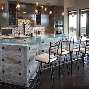 Rustic kitchen pictures - Kitchen - rustic kitchen idea in Denver with glass-front cabinets, dark wood cabinets, multicolored backsplash, mosaic tile backsplash, paneled appliances and an island