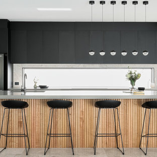 Mid-sized contemporary galley kitchen in Brisbane with an undermount sink, flat-panel cabinets, black cabinets, window splashback, stainless steel appliances, porcelain floors, with island, grey floor and grey benchtop.