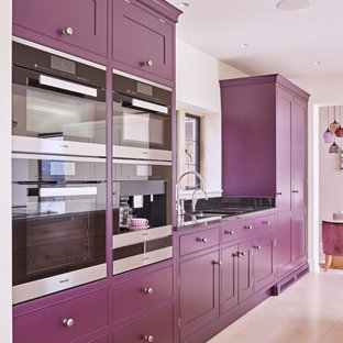 Design ideas for a large contemporary kitchen/diner in Other with an integrated sink, shaker cabinets, purple cabinets, granite worktops, stainless steel appliances, limestone flooring, an island, beige floors and white worktops.