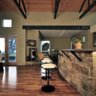 Exemple d'une très grande cuisine ouverte parallèle tendance avec un évier 2 bacs, un placard à porte vitrée, des portes de placard en bois clair, un plan de travail en surface solide, une crédence multicolore, une crédence en mosaïque, un électroménager en acier inoxydable, un sol en ardoise, aucun îlot et un sol multicolore.