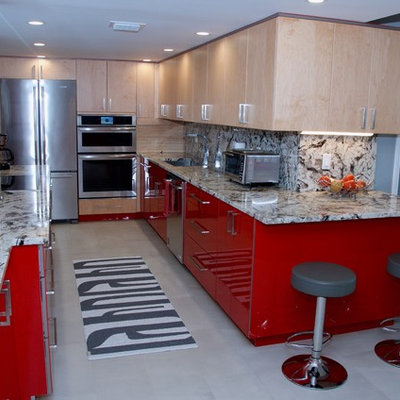 Inspiration for a large contemporary galley kitchen remodel in Miami with an undermount sink, flat-panel cabinets, red cabinets, granite countertops, stainless steel appliances and a peninsula
