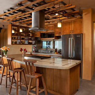 Southwestern kitchen ideas - Inspiration for a southwestern kitchen remodel in Albuquerque with shaker cabinets, medium tone wood cabinets, multicolored backsplash and stainless steel appliances