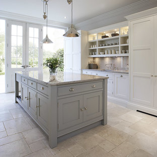 Design ideas for a mid-sized transitional open plan kitchen in Manchester with grey cabinets, granite benchtops, marble floors, an island and beaded inset cabinets.