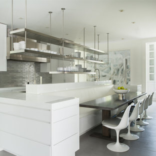Design ideas for a contemporary eat-in kitchen in New York with recycled glass benchtops, with island, open cabinets, stainless steel cabinets, panelled appliances, metallic splashback and metal splashback.