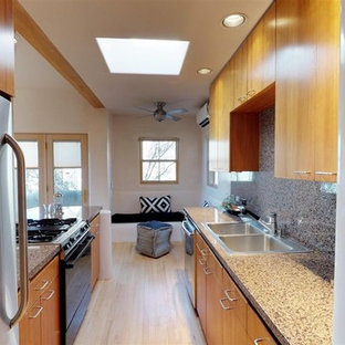 Mid-sized southwestern eat-in kitchen remodeling - Eat-in kitchen - mid-sized southwestern l-shaped light wood floor and brown floor eat-in kitchen idea in Other with a double-bowl sink, shaker cabinets, medium tone wood cabinets, granite countertops, multicolored backsplash, stainless steel appliances and a peninsula