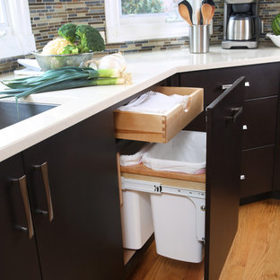 Large contemporary eat-in kitchen designs - Eat-in kitchen - large contemporary u-shaped light wood floor eat-in kitchen idea in Chicago with an undermount sink, flat-panel cabinets, black cabinets, quartz countertops, beige backsplash, mosaic tile backsplash and stainless steel appliances