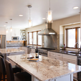 Design ideas for a contemporary kitchen in Minneapolis with mosaic tiled splashback, brown splashback, recessed-panel cabinets, white cabinets, stainless steel appliances and multiple islands.
