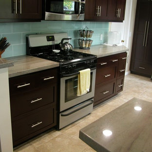 Inspiration for a mid-sized contemporary u-shaped kitchen pantry in Los Angeles with an undermount sink, shaker cabinets, dark wood cabinets, granite benchtops, blue splashback, glass tile splashback, stainless steel appliances, porcelain floors and no island.