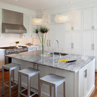 Inspiration for a contemporary kitchen remodel in Philadelphia with paneled appliances, a single-bowl sink, beaded inset cabinets, white cabinets and marble countertops