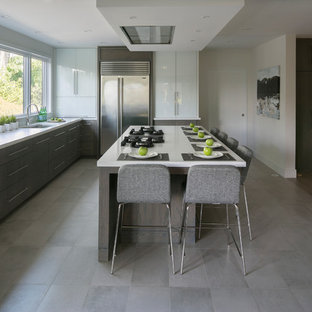 Large contemporary kitchen designs - Kitchen - large contemporary l-shaped porcelain tile kitchen idea in New York with an undermount sink, flat-panel cabinets, medium tone wood cabinets, quartz countertops, white backsplash, glass tile backsplash, stainless steel appliances and an island