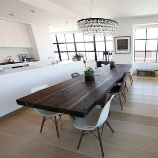 Contemporary eat-in kitchen appliance - Trendy galley eat-in kitchen photo in Salt Lake City with an integrated sink, flat-panel cabinets, white cabinets and white backsplash