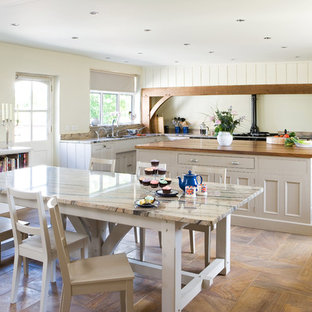 Inspiration for a large country l-shaped eat-in kitchen in Other with beige cabinets and with island.
