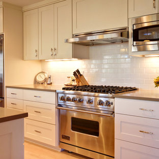 Inspiration for a contemporary kitchen in Minneapolis with stainless steel appliances and metro tiled splashback.