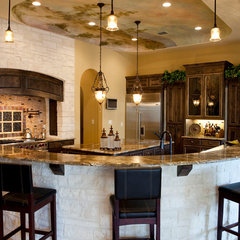 mediterranean kitchen by Designs and Details Interiors