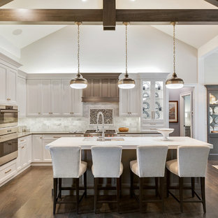 Traditional eat-in kitchen designs - Eat-in kitchen - traditional l-shaped dark wood floor and brown floor eat-in kitchen idea in Chicago with an undermount sink, shaker cabinets, white cabinets, multicolored backsplash, marble backsplash, stainless steel appliances, an island and gray countertops
