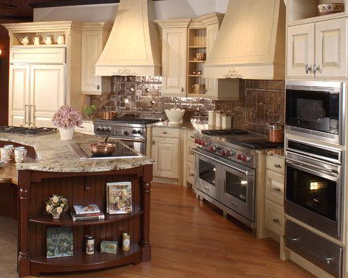 midsized elegant lshaped medium tone wood floor enclosed kitchen photo in boston