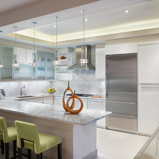 Kitchen - mid-sized contemporary kitchen idea in Miami with flat-panel cabinets, white cabinets, white backsplash and stainless steel appliances