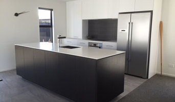 Corian benchtops with black and white cabinetry