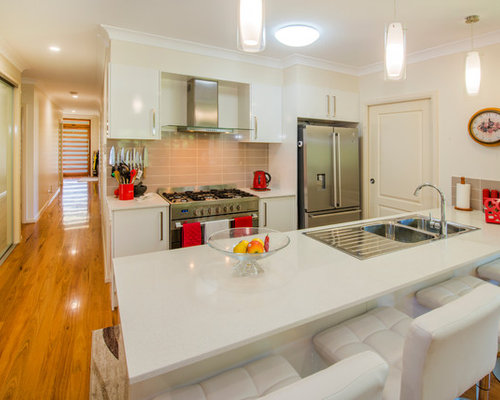 Transitional Galley Kitchen In Sydney With A Drop In Sink, Flat Panel  Cabinets