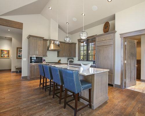 Rustic kitchen designs - Inspiration for a rustic l-shaped medium tone wood  floor and
