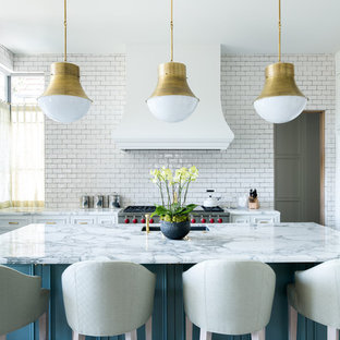 Mid-sized contemporary eat-in kitchen designs - Example of a mid-sized trendy u-shaped medium tone wood floor and brown floor eat-in kitchen design in Dallas with an undermount sink, beaded inset cabinets, white cabinets, marble countertops, white backsplash, subway tile backsplash, paneled appliances and an island