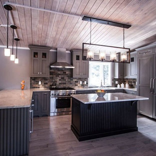 This is an example of a mid-sized transitional u-shaped eat-in kitchen in Chicago with a farmhouse sink, flat-panel cabinets, green cabinets, quartzite benchtops, multi-coloured splashback, stone tile splashback, panelled appliances, light hardwood floors and with island.