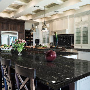 Design ideas for a large contemporary galley open plan kitchen in Baltimore with louvered cabinets, white cabinets, granite benchtops, black splashback, stone slab splashback, stainless steel appliances, marble floors, multiple islands and beige floor.