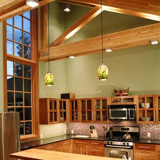 Small craftsman eat-in kitchen ideas - Eat-in kitchen - small craftsman u-shaped medium tone wood floor eat-in kitchen idea in Other with an undermount sink, recessed-panel cabinets, medium tone wood cabinets, granite countertops, red backsplash, glass tile backsplash, stainless steel appliances and a peninsula