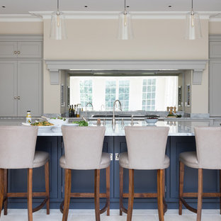 Large classic kitchen in Oxfordshire with shaker cabinets, grey cabinets, mirror splashback, stainless steel appliances, an island, beige floors and grey worktops.